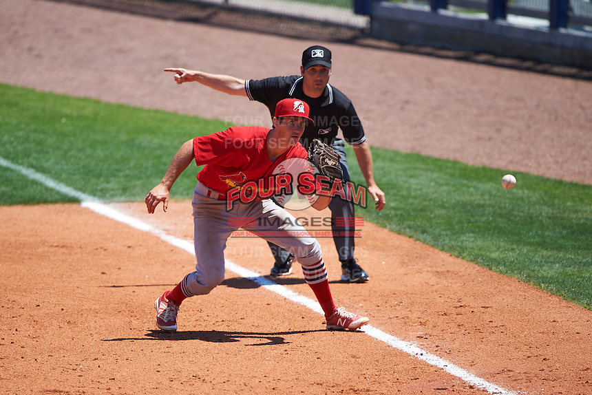 Palm Beach Cardinals first baseman Danny Diekroeger (3) fields a batted ball as umpire Grant Conrad signals fair during a game against the Charlotte Stone Crabs on April 10, 2016 at Charlotte Sports Park in Port Charlotte, Florida.  Palm Beach defeated Charlotte 4-1.  (Mike Janes/Four Seam Images)