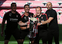 27th May 2018, Wembley Stadium, London, England;  EFL League 1 football, playoff final, Rotherham United versus Shrewsbury Town; Rotherham United manager Paul Warne alongside his coaching staff holds up the EFL League 1 trophy in front of the Rotherham United fans