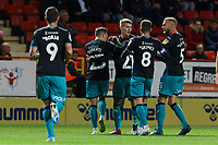 Yan Dhanda of Swansea (C) City celebrates his goal during the Sky Bet Championship match between Charlton Athletic and Swansea City at The Valley, London, England, UK. Wednesday 02 October 2019