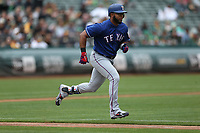 OAKLAND, CA - APRIL 5:  Elvis Andrus #1 of the Texas Rangers runs to first base against the Oakland Athletics during the game at the Oakland Coliseum on Thursday, April 5, 2018 in Oakland, California. (Photo by Brad Mangin)
