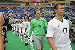 07 August 2008: Captain Brian McBride (USA) (17) and goalkeeper Brad Guzan (USA) (18) lead the team onto the field, pregame.  The men's Olympic team of the United States defeated the men's Olympic soccer team of Japan 1-0 at Tianjin Olympic Center Stadium in Tianjin, China in a Group B round-robin match in the Men's Olympic Football competition.