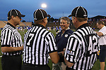 29 April 2016: Notre Dame head coach Kevin Corrigan greets the officials before the match. The University of Notre Dame Fighting Irish played the Duke University Blue Devils at Fifth Third Bank Stadium in Kennesaw, Georgia in a 2016 Atlantic Coast Conference Men's Lacrosse Tournament semifinal match. Duke won the game 10-9 in overtime.