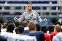 7 August 2011:  FIU Head Coach Mario Cristobal addresses his players after the first day of fall practice with full pads at University Park Stadium in Miami, Florida.