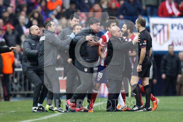 Atletico de Madrid´s second Coach German `El Mono´ Burgos (2L) tries to fight with the referee while arguing with him after a decision during La Liga match in Vicente Calderon stadium in Madrid, Spain. March 02, 2014. (ALTERPHOTOS/Victor Blanco)