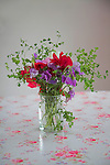 Sweet pea flowers in vase on kitchen table