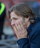 Wycombe Wanderers Manager Gareth Ainsworth covers his face during the Sky Bet League 2 match between Leyton Orient and Wycombe Wanderers at the Matchroom Stadium, London, England on 19 September 2015. Photo by Andy Rowland.