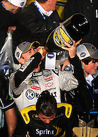 Nov. 16, 2008; Homestead, FL, USA; NASCAR Sprint Cup Series driver Jimmie Johnson drinks champagne after winning the 2008 championship following the Ford 400 at Homestead Miami Speedway. Mandatory Credit: Mark J. Rebilas-