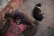 A villager with his dog in Borapahari in Jharia, Jharkhand, India. Photo: Sanjit Das