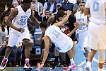 24 January 2015: North Carolina's Brice Johnson (11) has his foot get caught on the ball as it is picked up by Florida State's Boris Bojnovsky (behind) as North Carolina's Joel James (42) and Marcus Paige (5) watch. The University of North Carolina Tar Heels played the Florida State University Seminoles in an NCAA Division I Men's basketball game at the Dean E. Smith Center in Chapel Hill, North Carolina. UNC won the game 78-74.