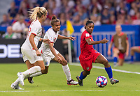 LYON,  - JULY 2: Rachel Daly #17 and Nikita Parris #7 defend Crystal Dunn #19 during a game between England and USWNT at Stade de Lyon on July 2, 2019 in Lyon, France.