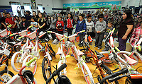 NWA Media/ J.T. Wampler - Thirty children stand dumbfounded as they are told they were given new bicycles Thursday Dec. 18, 2014 at Northside Elementary in Rogers. Academy Sports + Outdoors donated the bikes and helmets the deserving students (15 girls and 15 boys) as part of Academy's annual bike donation program.
