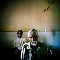 Two men affected by malaria in a Sundargarh hospital, Orissa, which is the Indian state most affected by malaria, with 25 to 30 percent of all malaria cases diagnosed in the country.