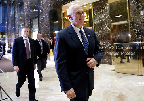 United States Vice President-elect Mike Pence exits after he speaks to reporters in the lobby of Trump Tower on November 29, 2016 in New York City. U.S. President-elect Donald Trump is still holding meetings upstairs at Trump Tower as he continues to fill in key positions in his new administration.    <br /> Credit: John Angelillo / Pool via CNP