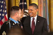 Sergeant First Class Leroy Arthur Petry, U.S. Army, talks to U.S. President Barack Obama after receiving from him the Medal of Honor for conspicuous gallantry and intrepidity at the risk of his life above and beyond the call of duty in the East Room of the White House in Washington D.C., July 12, 2011.  Sergeant Petry is receiving the medal for his courageous actions during combat operations against an armed enemy in Paktya, Afghanistan in May, 2008 and is the second living, active duty service member to be awarded the Medal of Honor for actions in Iraq or Afghanistan. .Credit: Allison Shelley / Pool via CNP