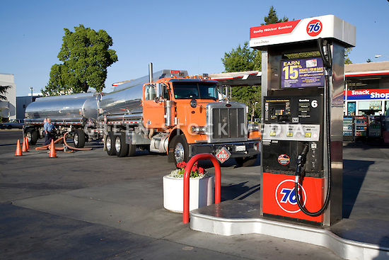 A gas truck delivering gasoline at a gas station. Mountain View, California, USA