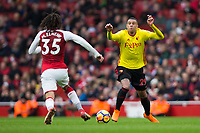 Watford's Etienne Capoue vies for possession with Arsenal's Mohamed Elneny <br /> <br /> Photographer Craig Mercer/CameraSport<br /> <br /> The Premier League - Sunday 11th March 2018 - Arsenal v Watford - The Emirates - London<br /> <br /> World Copyright &copy; 2018 CameraSport. All rights reserved. 43 Linden Ave. Countesthorpe. Leicester. England. LE8 5PG - Tel: +44 (0) 116 277 4147 - admin@camerasport.com - www.camerasport.com