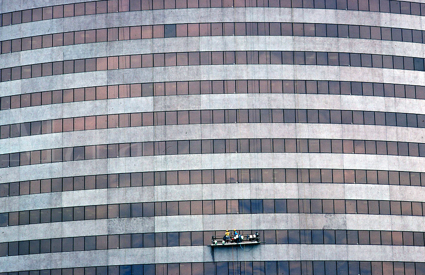 Wide overview of office building exterior with window washers on a platform ladder, window washing, architecture, not MR but for PR, contact photographer.