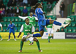 Hibs v St Johnstone....27.11.10  .Collin Samuel sclafs the ball as he is through on goal.Picture by Graeme Hart..Copyright Perthshire Picture Agency.Tel: 01738 623350  Mobile: 07990 594431
