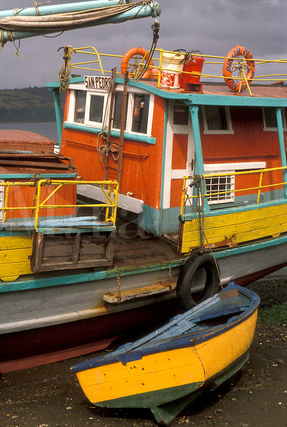 AJ2086, boats, Chile, Chiloe Island, Colorful fishing boats beached at low tide on the Pacific Ocean in Castro on Chiloe Island in Chile.