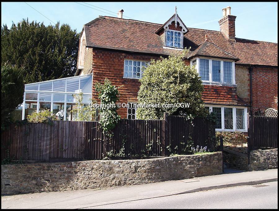 BNPS.co.uk (01202 558833)<br /> Pic: OnTheMarket.com/CGW/BNPS<br /> <br /> A character cottage where literary great George Eliot penned the classic novel Middlemarch has got tongues wagging again after it went on the market for &pound;799,950.<br /> <br /> Brookbank Cottage in Haslemere, Surrey, is where Mary Ann Evans - her birth name - lived temporarily with her married lover George Henry Lewes while their London home was being renovated in 1871.<br /> <br /> They rented the three bed home, which Eliot called a 'queer little cottage', from Anne Gilchrist, another English writer and member of the London Literary Society.