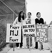 Santa Maria, California.USA.April 2005..These three young girls come every morning to cheer on Michael Jackson as he enters the courthouse at 8:30 AM for his child abuse trial. They do this every morning before going to school at 9AM...Mr. Jackson, 46, denies all 10 charges against him, including child abuse. He faces up to 20 years in jail if convicted on all charges.