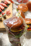 Apr 10, 2010 - Tokyo, Japan - Imitation hamburgers are displayed at a restaurant supply store located in Kappabashi street in Tokyo on April 10, 2010. Kappabashi-dori, also known just as Kappabashi or Kitchen Town, is almost entirely populated with shops supplying mass-produced crockery, restaurant furniture, ovens and decorations, through to esoteric items such as the plastic display food  (sampuru). Replica foods are also popular as souvenirs for tourists.