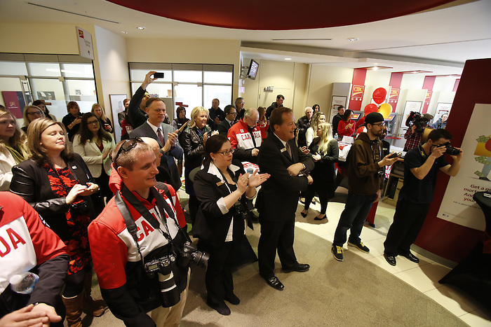 Ottawa, ON - March 28 2014 - The crowd gathers to hear from the athletes and view the presentation of limited edition gold-plated coin and personalized Welcome Home banners to Ottawa's Sochi Paralympians at the CIBC Paralympic Welcome Home Event at CIBC South Keys Banking Centre in Ottawa (Photo: Patrick Doyle/CIBC)