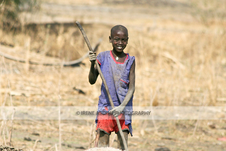 Traditionally nomadic, a Dinka boy lives in  a cattle camp near Rumbek, South Sudan.