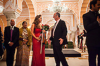 Australian violinist Niki Vasilakis (center, left) and Australia's High Commissioner to India Dr. Lachlan Strahan (center, right) share a light conversation after her solo violin concert played to a prominent audience, including the Jaipur Royal Family, and other VIPs at the OzFest Gala Dinner in the Jaipur City Palace, in Rajasthan, India on 10 January 2013. Photo by Suzanne Lee