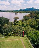 SRI LANKA, Asia, high angle view of a woman looking at Kandalama lake