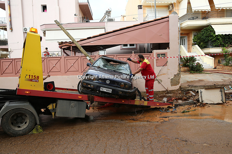 Pictured: A car swept away by floods is recovered in the Mandra area, in the outskirts of Athens, Greece. Wednesday 27 June 2018<br /> Re: Flashflooding has been caused by storm Nefeli in parts of Greece.