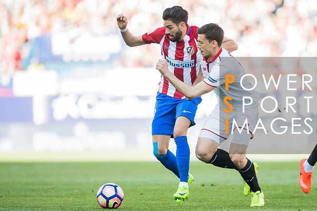Yannick Ferreira Carrasco (l) of Atletico de Madrid competes for the ball with Clement Lenglet of Sevilla FC during their La Liga match between Atletico de Madrid and Sevilla FC at the Estadio Vicente Calderon on 19 March 2017 in Madrid, Spain. Photo by Diego Gonzalez Souto / Power Sport Images