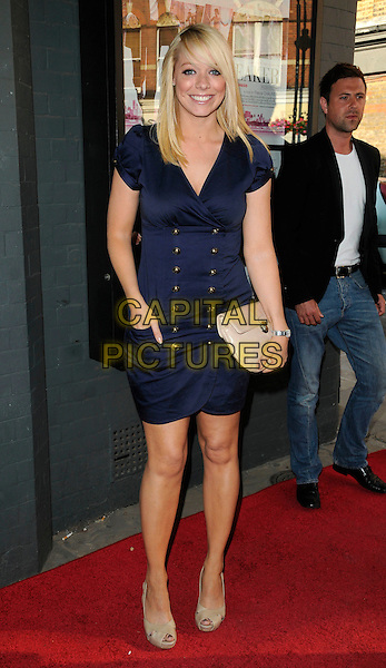 "LIZ McCLARNON .attends a gala screening of ""Heartbreaker"" in London, England, June 28th, 2010..Full length brass buttons ruched dress nautical hand in pocket beige clutch bag peep toe shoes  blue navy .CAP/CAN.©Can Nguyen/Capital Pictures."