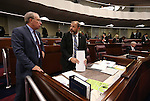 Nevada Assembly Republicans Pat Hickey and Paul Anderson talk on the Assembly floor at the Legislative Building in Carson City, Nev., on Wednesday, Dec. 16, 2015. Gov. Brian Sandoval called lawmakers into a special session Wednesday to consider a package of tax incentives to bring the startup electric car manufacturer Faraday Future to Southern Nevada. (Cathleen Allison/Las Vegas Review-Journal)