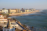 Coastal view east of sandy beaches and apartment housing, Cadiz, Spain