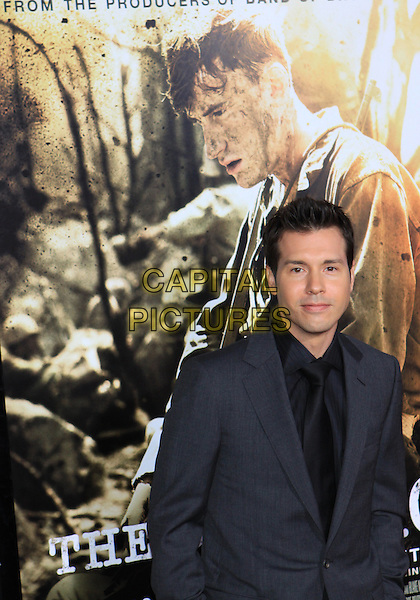 "JON SEDA .Attending the Los Angeles Premiere of HBO's ""The Pacific"" held at Grauman's Chinese Theater, Hollywood, California, USA, 24th February 2010 .half length grey gray suit jacket black shirt tie .CAP/ADM/TC.©T. Conrad/AdMedia/Capital Pictures."