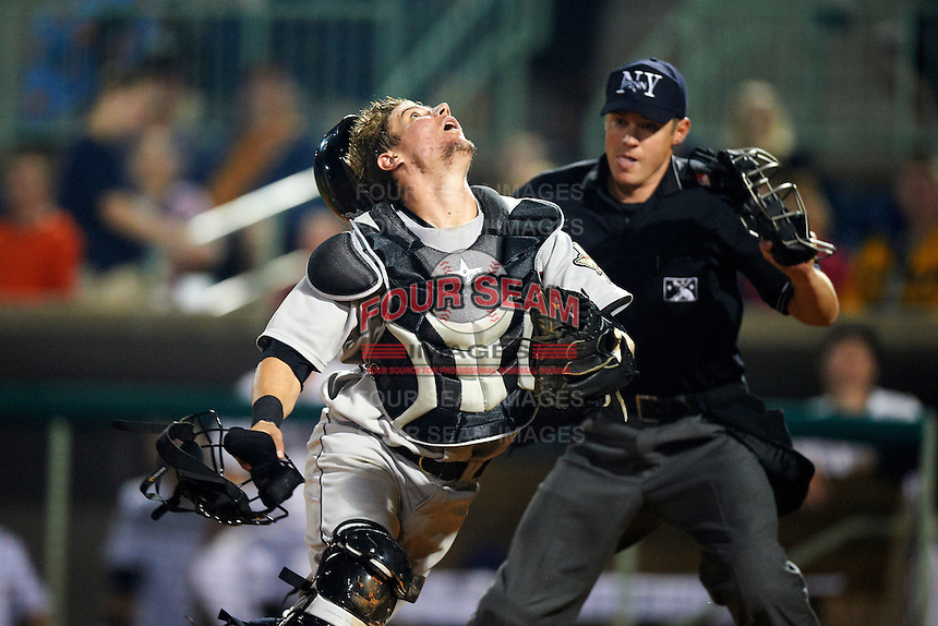 Tri-City ValleyCats catcher Tyler Heineman #26 looks for a pop up foul ball in front of umpire Clayton Hamm during the NY-Penn League All-Star Game at Eastwood Field on August 14, 2012 in Niles, Ohio.  National League defeated the American League 8-1.  (Mike Janes/Four Seam Images)
