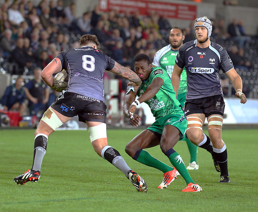 Connacht Rugby's Niyi Adeolokun gets a hand off from Ospreys's Ieuan Jones <br /> <br /> Photographer Simon King/CameraSport<br /> <br /> Rugby Union - Guinness PRO12 - Ospreys v Connacht Rugby - Friday 31st October 2014 - The Liberty Stadium - Swansea<br /> <br /> &copy; CameraSport - 43 Linden Ave. Countesthorpe. Leicester. England. LE8 5PG - Tel: +44 (0) 116 277 4147 - admin@camerasport.com - www.camerasport.com