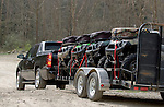 Black Chevy Avalanche Towing Kawasaki ATVs in West Virginia