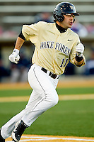 Pat Blair #11 of the Wake Forest Demon Deacons hustles down the first base line against the Georgetown Hoyas at Wake Forest Baseball Park on February 26, 2012 in Winston-Salem, North Carolina.  (Brian Westerholt / Four Seam Images)