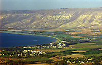 View of the southern end of the Sea of Galilee.  Israeli farms are in the foreground, the Golan Heights are in the background.
