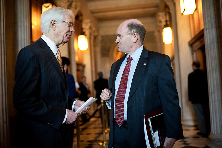UNITED STATES - MAY 14: Sens. Chris Coons, D-Del., right, and Thad Cochran, R-Miss., speaks outside the Senate chamber in the Capitol, May 14, 2015. (Photo By Tom Williams/CQ Roll Call)