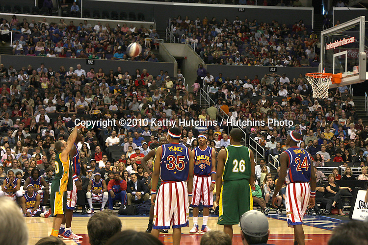 Flea playing on team against Globetrotters.at the Harlem Globetrotters Game .Staples Center.Los Angeles, CA.February 14, 2010.©2010 Kathy Hutchins / Hutchins Photo....