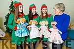 Elfs Lauren Smullins, Mary Ann Fleming and Coimhe Leahy with Pat Parrish who knitted the dolls, standing at the John Mitchels GAA Club Christmas Market on Saturday.