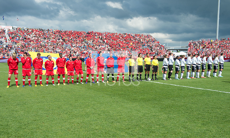 02 June 2013: The U.S. Women's National Team and the Canadian Women's National Team participate in the national anthems and opening ceremonies during an International Friendly soccer match between the U.S. Women's National Soccer Team and the Canadian Women's National Soccer Team at BMO Field in Toronto, Ontario.<br /> The U.S. Women's National Team Won 3-0.