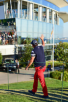 Phil Mickelson (USA) departs 14 and waves to President Trump watching from the upper level of the clubhouse during round 4 Singles of the 2017 President's Cup, Liberty National Golf Club, Jersey City, New Jersey, USA. 10/1/2017. <br /> Picture: Golffile | Ken Murray<br /> <br /> All photo usage must carry mandatory copyright credit (&copy; Golffile | Ken Murray)