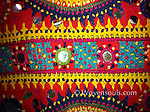 Vintage sari from the Kutch Patel community, circa 1930. Extravagntly and finely embroidered and worn at weddings. The wearing style is unique for this group and one edge is always cut in to allow wearing it in this style. The base cloth is dyed in a mineral dye (iron) that is corrosive over the years and therefore there are several spots of damage on the sari.