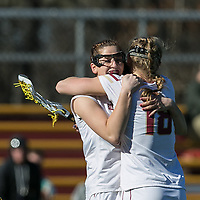 Newton, Massachusetts - February 27, 2018: NCAA Division I. Boston College (white) defeated Navy (blue), 19-14, at Newton Lacrosse Complex.<br /> Goal celebration.