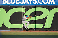 Tampa Tarpons center fielder Ben Ruta (6) collides with the wall attempting to catch a fly ball during a game against the Dunedin Blue Jays on June 2, 2018 at Dunedin Stadium in Dunedin, Florida.  Dunedin defeated Tampa 4-0.  (Mike Janes/Four Seam Images)