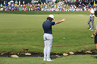 Tommy Fleetwood (ENG) takes a penalty drop after landing his 2nd shot in the creek at the 18th green during Saturday's Round 3 of the 2017 PGA Championship held at Quail Hollow Golf Club, Charlotte, North Carolina, USA. 12th August 2017.<br /> Picture: Eoin Clarke | Golffile<br /> <br /> <br /> All photos usage must carry mandatory copyright credit (&copy; Golffile | Eoin Clarke)